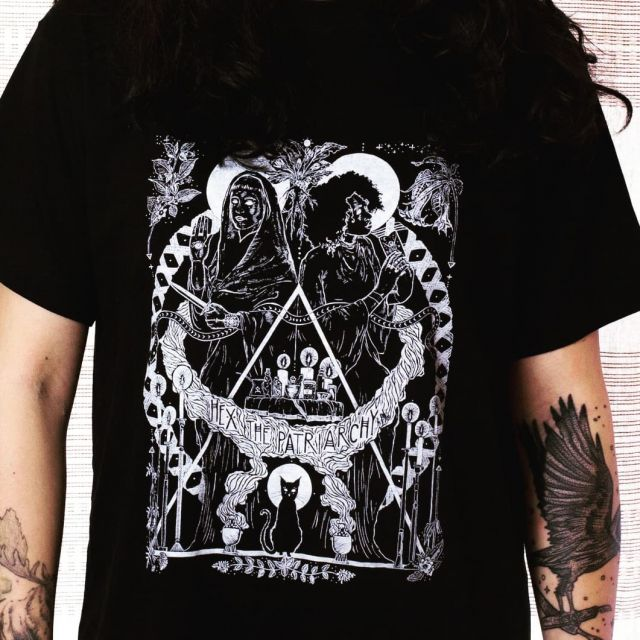 """""""Hex the Patriarchy"""" shirts are back in stock after a small print run. Celebrating serpent and feline guardians and so-called 'witches weeds' from the SWANA region.  #screenprint #reliefprint #witches #witchcraft #herbalism #soorj #tasseography #evileye #blackcat #serpents #dagger #hexthepatriarchy"""